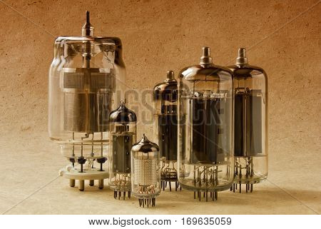 electronic vacuum tubes on kraft paper background in warm tone