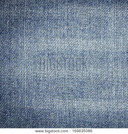 Denim jeans texture or denim jeans background. Old grunge vintage denim jeans. Stitched texture denim jeans background of fashion jeans design. Dark edged. Dark edged.