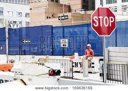 Construction Worker Having A Break