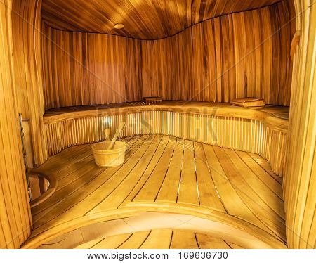 spacious interior of empty wooden a steam room. Sauna in the house