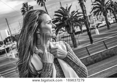 Young Tourist Woman In Barcelona, Spain Looking Into Distance