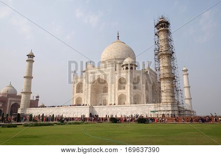 AGRA, INDIA - FEBRUARY 14: Taj Mahal (Crown of Palaces), an ivory-white marble mausoleum on the south bank of the Yamuna river in Agra, Uttar Pradesh, India on February 14, 2016.
