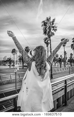 Tourist Woman On Embankment In Barcelona, Spain Rejoicing