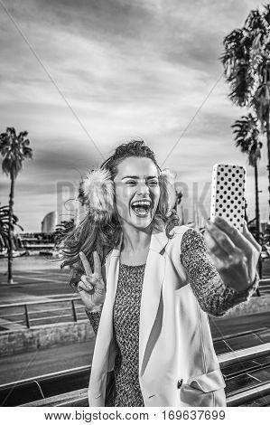Happy Woman In Barcelona, Spain Taking Selfie With Smartphone
