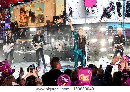 NEW YORK-DEC 31: Recording artist Carrie Underwood performs during Dick Clark's New Year's Rockin' Eve at Times Square on December 31, 2015 in New York City.