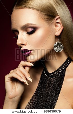 Beautyful girl with pink glitter on her lips and eyes