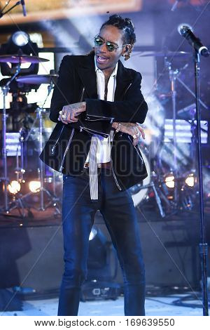 NEW YORK-DEC 31: Recording artist Wiz Khalifa performs during Dick Clark's New Year's Rockin' Eve at Times Square on December 31, 2015 in New York City.