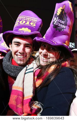 NEW YORK-DEC 31: Guido Yujno (L) and Julieta Gorbato from Argentina attend Dick Clark's New Year's Rockin' Eve at Times Square on December 31, 2015 in New York City.