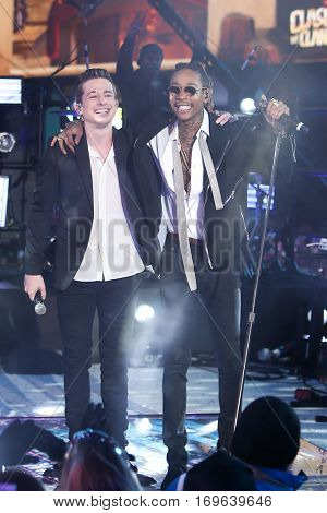NEW YORK-DEC 31: Recording artists Charlie Puth (L) and  Wiz Khalifa perform during Dick Clark's New Year's Rockin' Eve at Times Square on December 31, 2015 in New York City.