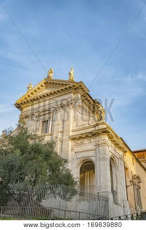 Santa Francesca Romana previously known as Santa Maria Nova is a church in Rome Italy situated next to the Roman Forum in the rione Campitelli.