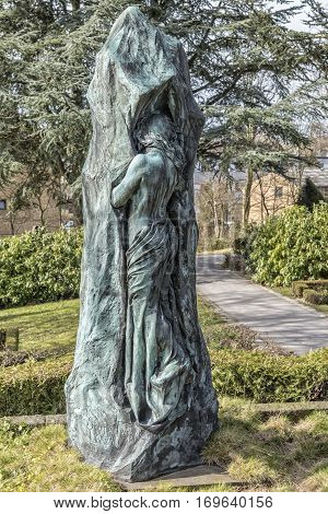 HELSINGOR DENMARK - MARCH 28 2016: Rudolph Tegners monument to his mother situated in Helsingor Graveyard.