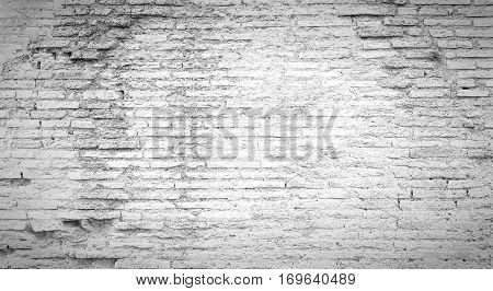 A grungy white background texture of an ancient wall from the colosseum in Rome Italy.