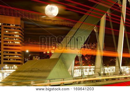 The super moon in Columbus, Ohio with traffic from the Main Street Bridge in the foreground