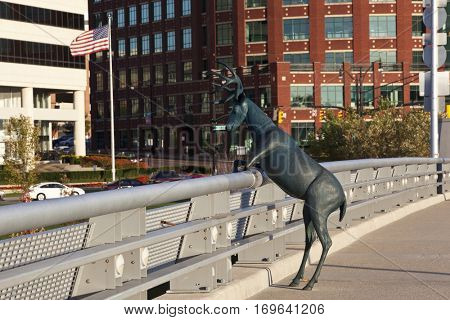 COLUMBUS, OHIO - OCTOBER 22, 2016:  The Columbus deer statue overlooks the skyline along the Scioto River on the Rich Street Bridge.