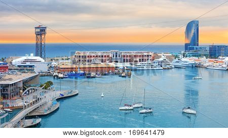 Barcelona cruise port, public promenade and cable car over Barceloneta at sunset