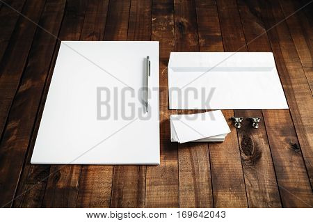 Blank stationery set on wooden table background. ID template. Mock up for branding identity for design presentations and portfolios. Blank letterhead business cards envelope and pen.