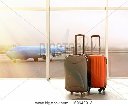 Suitcases at airport near window. Traveling concept