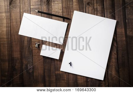 Photo of blank corporate identity. Stationery set. Branding mockup. Sheets of paper letterhead business cards envelope and pencil.