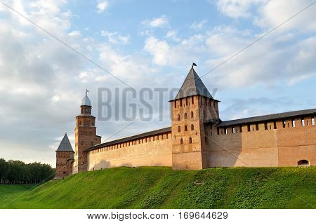 Towers of Veliky Novgorod Kremlin Russia under colorful dramatic summer sky. Architecture Russian landscape of veliky novgorod Russia in sunny summer evening