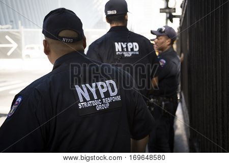 NEW YORK - SEPT 11 2016: Members of the NYPD Strategic Response Group across from the World Trade Center site at Church St on patrol on the 15th anniversary of the 9/11 terror attacks.