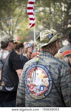 NEW YORK - SEPT 11 2016: A US veteran walks in Lower Manhattan to pay their respect during the annual Honor Ride commemorating the 9/11 terrorist attacks.