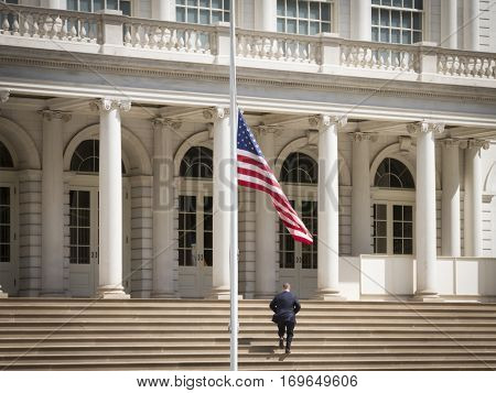 NEW YORK - SEPT 11 2016: The American Flag flies at half mast in front of Gracie Mansion in Lower Manhattan on the 15th anniversary of the terror attacks at the World Trade Center.