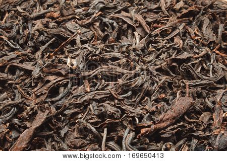 This Ceylon black tea dry background texture