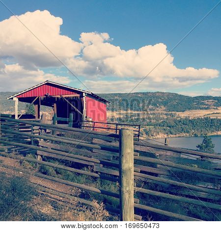 Red Stable And Fence On Hillside