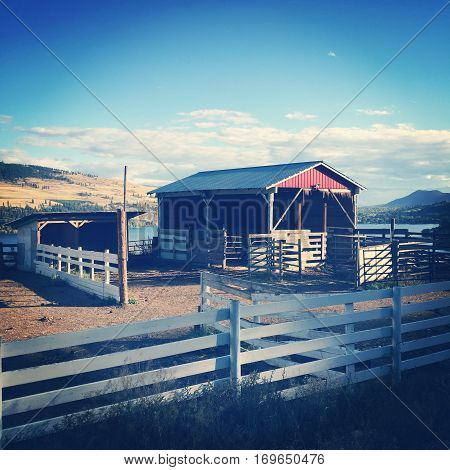 Red Stable And White Fence