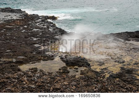 The Spouting Horn is probably the most photographed blowhole on Kaua'i Island Hawai'i