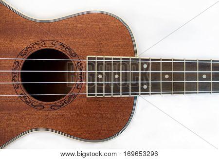 Part of the ukulele on white background isolated image