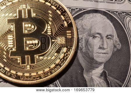 One Bitcoin on dollar banknote. Closeup, macro shot