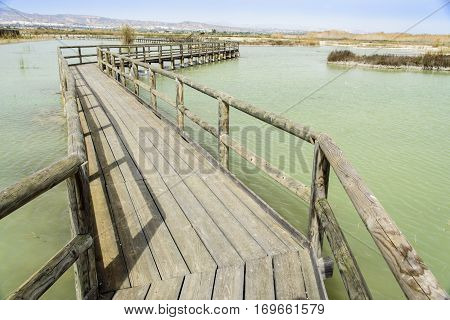 Old wooden bridge through the lake, Spain