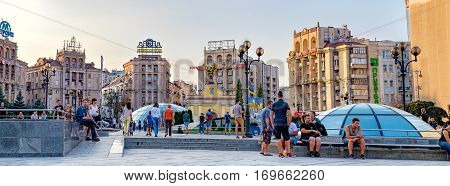 Kiev, Ukraine - September 11, 2016: Maidan Nezalezhnosti Independence Square at weekend in Kiev. People walking through square passing cafes restaurants and shops