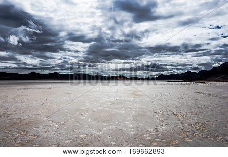 Storm clouds over desert mountain moonlike landscape