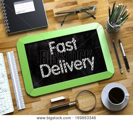 Small Chalkboard with Fast Delivery. Green Small Chalkboard with Handwritten Business Concept - Fast Delivery - on Office Desk and Other Office Supplies Around. Top View. 3d Rendering.