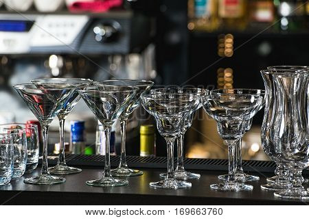 Glasses For A Margarita, Martini, Grog And Liqueur On A Bar At R