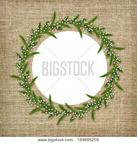 Round frame with lily of the valley flowers isolated on white