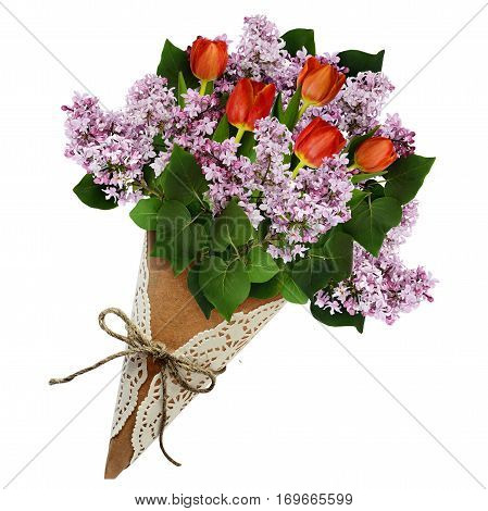 Lilac and tulip flowers bouquet in a craft paper cornet isolated on white