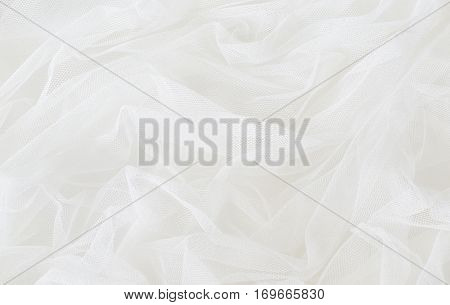 Closeup of white tulle drapery for background