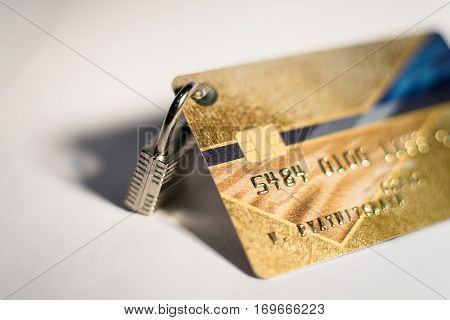 a credit card with small hanging padlock
