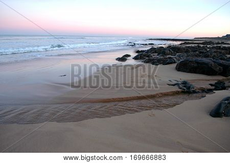 Rocky shore and sandy shore at sunset in Aberdenshire