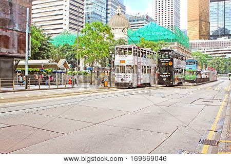 HONG KONG - MAY 15, 2014: Unidentified people are using city trams in Hong Kong. Tram in Hong Kong is the only tram system in the world run with double deckers