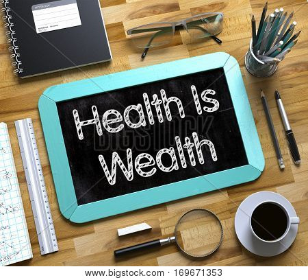 Small Chalkboard with Health Is Wealth Concept. Top View of Office Desk with Stationery and Mint Small Chalkboard with Business Concept - Health Is Wealth. 3d Rendering.