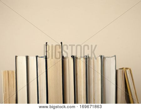 Composition of hardback books. Back to school . Education background Office supplies.