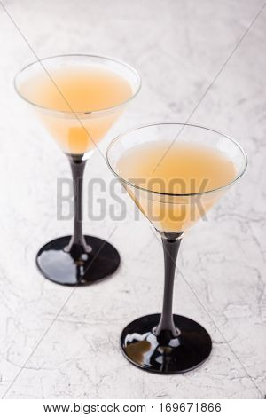 Martini with vodka in the cocktail glasses on white background
