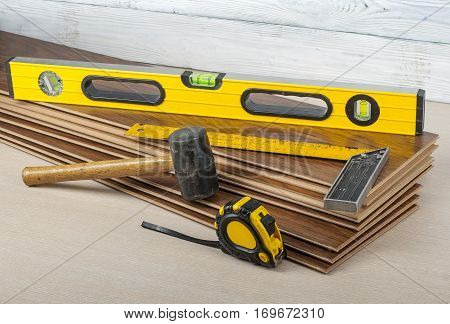 Tools for laining laminate flooring.Copy spase for text.