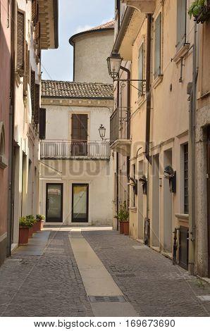 PESCHIERA DEL GARDA, ITALY - AUGUST 7, 2014: Street in Peschiera del Garda a village of Garda Lake and belong to the province of Verona in Veneto Italy.