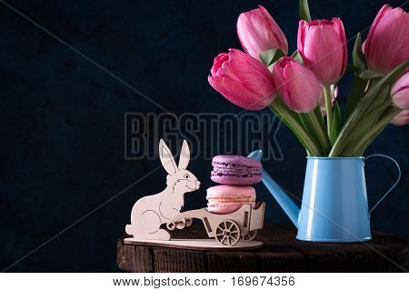 Easter Card With Colorful Eggs And Pink Tulips On Wooden Background