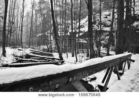 Snowy Wooden Railing At Entrance To Peklo Valley In Machuv Kraj Region In Czech Republic